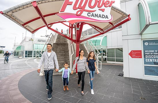 A family walks away from a set of stairs for FlyOver Canada.