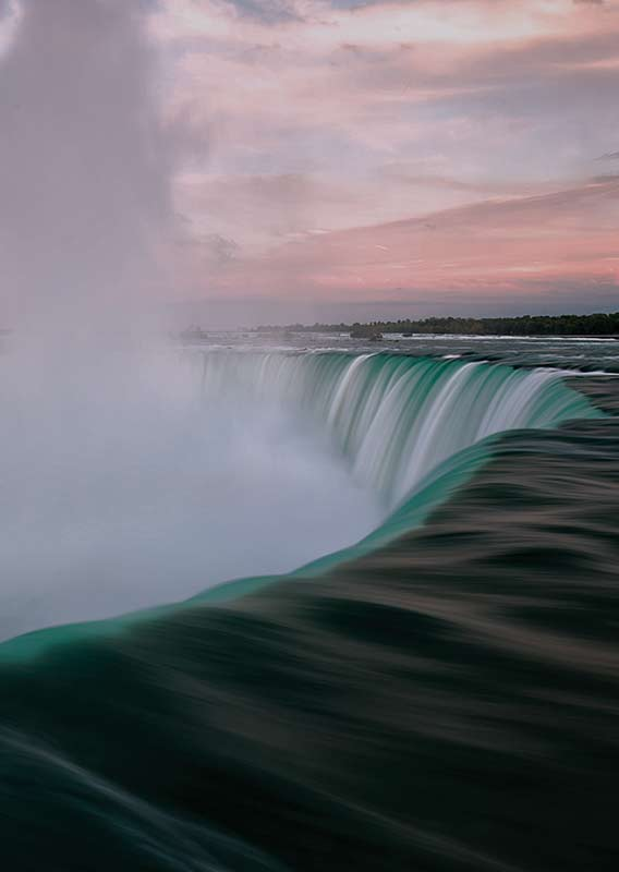 Large waterfall by sunset