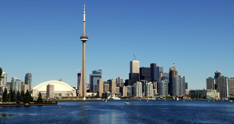 Toronto's skyline; featuring CN Tower towering above skyscrapers.