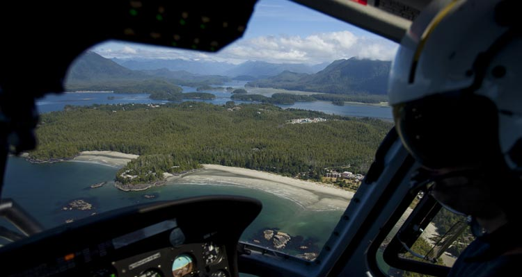 A view of beaches and forested islands from a helicopter