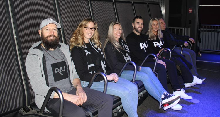 6 people from the RYU team sit on the FlyOver Canada flight-ride.
