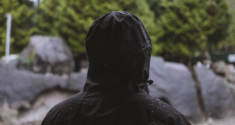 A person in a black rain jacket.